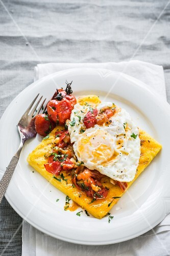 Grilled polenta with tomato sauce and a fried egg