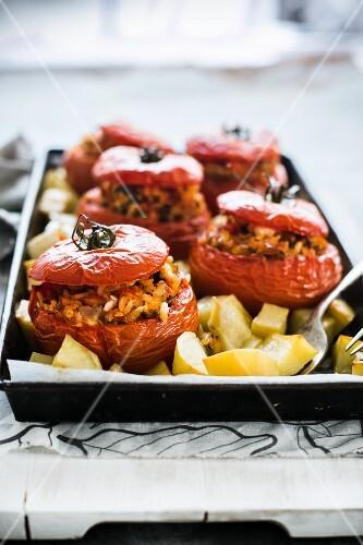 Pomodori col riso e patate (tomatoes stuffed with rice)