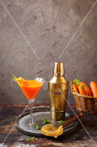 A cocktail with carrot juice and gin