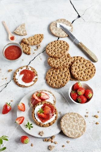 Crackers with strawberry and chia jam