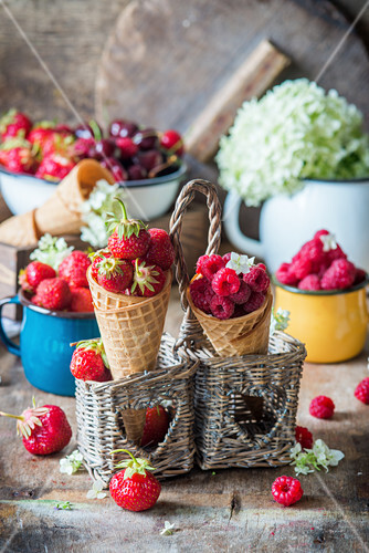 Strawberries and raspberries in ice cream cones