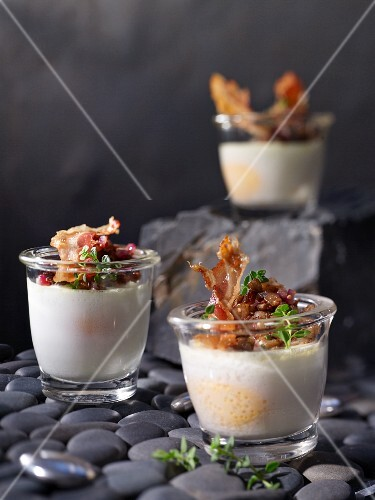 Poached eggs in glasses with oyster mushrooms, spring onions and pancetta