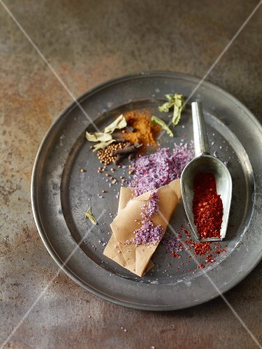 A still life of spices on a metal plate