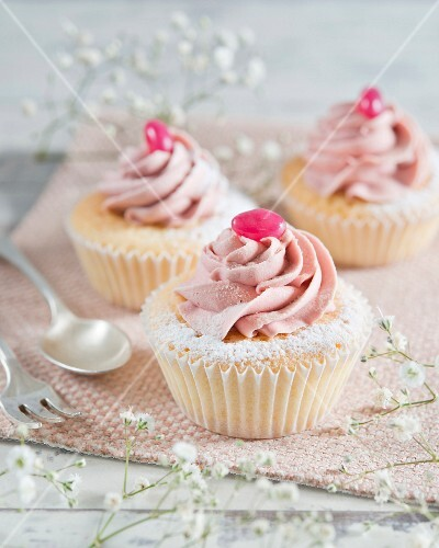 Cupcakes with buttercream and a pink jelly bean