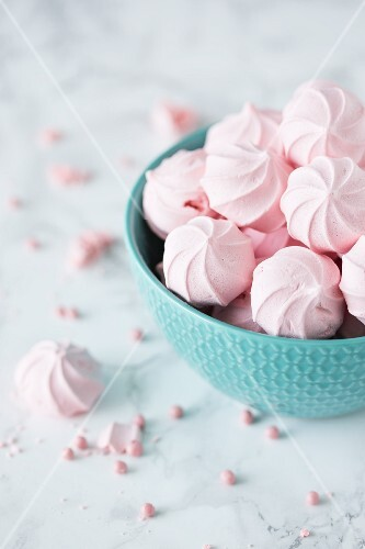 Pink mini meringues in a bowl
