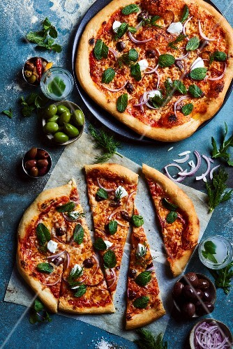 Pizza with mozzarella, olives and mint
