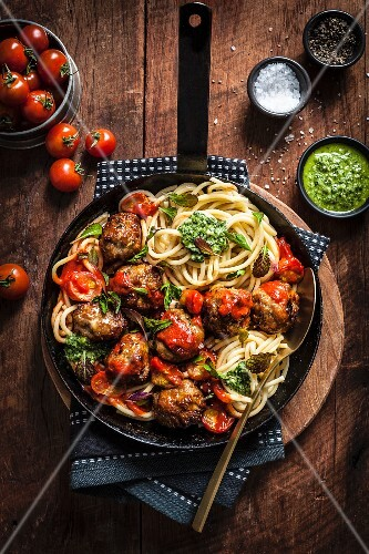 Pork and Fennel Meatballs with Spaghetti, Roast Tomato Sauce and Pesto