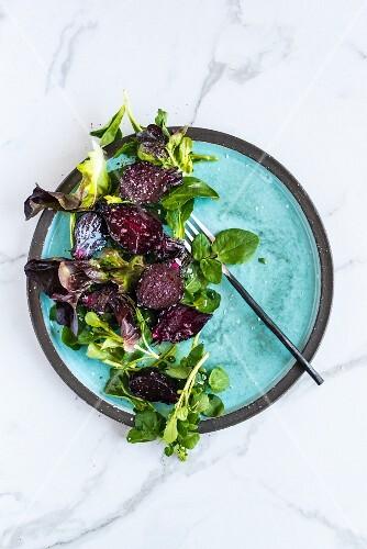 Beetroot salad garnished with lettuce leaves