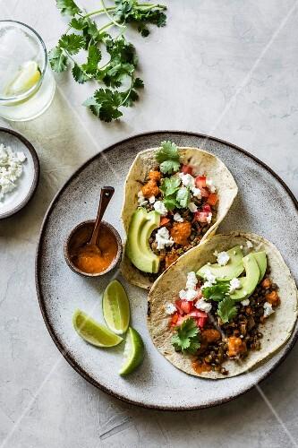 Taco with lentils, feta, avocado and smoked paprika powder