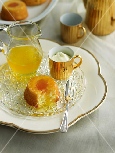 Upside down apricot cakes with orange syrup