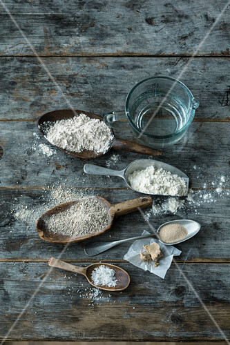 Bread ingredients: different types of flour, yeast, water and salt