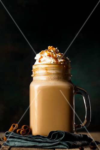 A caramel latte with cream