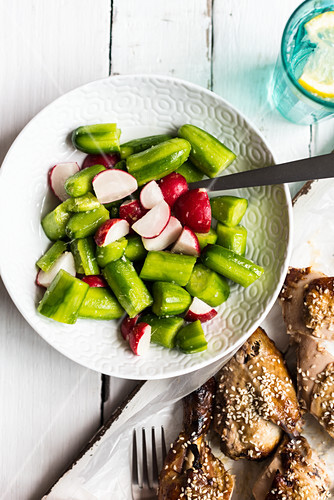 Baked cucumber salad with radishes and sesame chicken