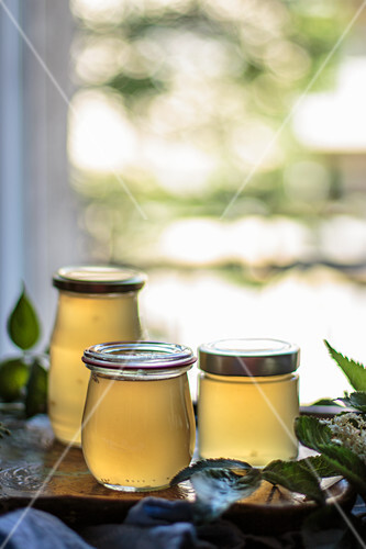 Apple and elderberry jelly in front of a window