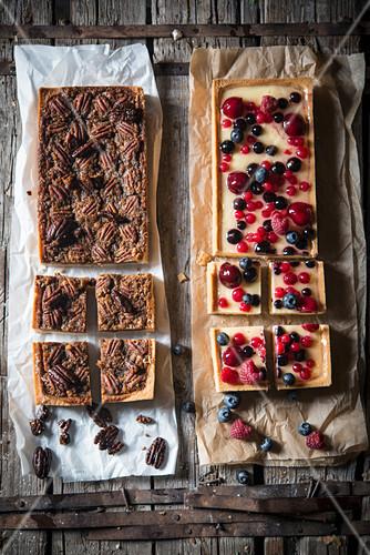 Pecan tart and red berry tart