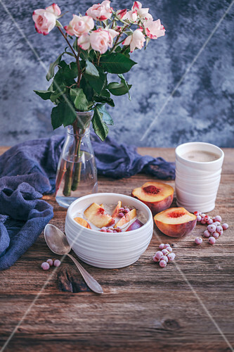Oats with peaches and red currant for breakfast