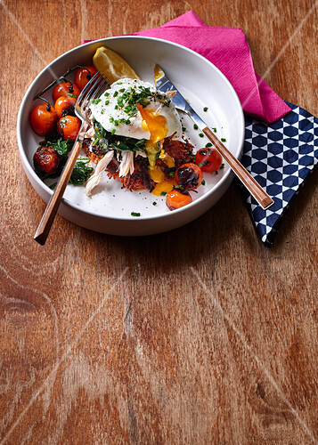 Parsnip fritters with chicken, vegetables and poached egg