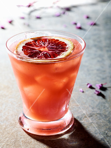 Single Blood Orange cocktail on a rustic surface