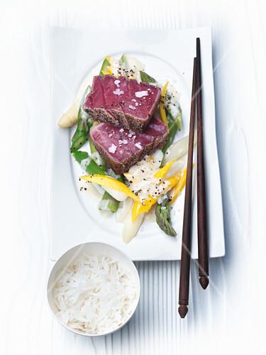 Pink seared tuna fish with asparagus salad and wasabi