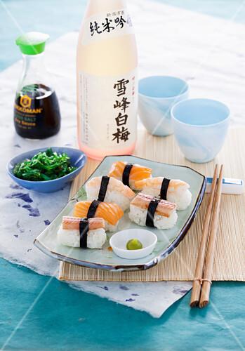 Nigiri sushi with smoked salmon, eel and shrimp