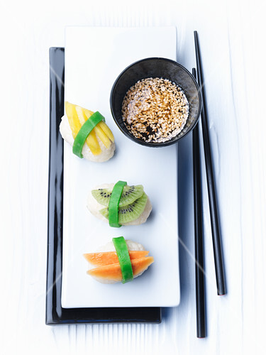 Sweet sushi with a sesame and honey dip