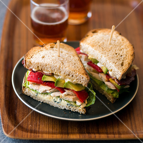 Chicken, bacon and Roquefort cheese sandwiches with beer