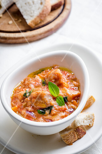 Pappa al pomodoro (bread and tomato soup, Italy) with red onions and basil
