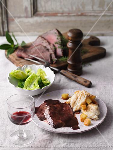 Red wine roast beef with floured dumplings