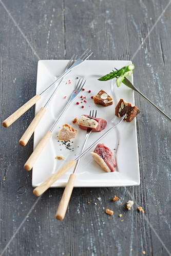 Fondue forks with ingredients