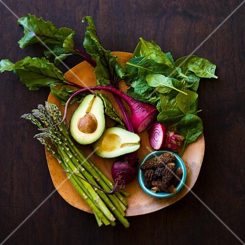 Fresh spring vegetables, avocado and morels