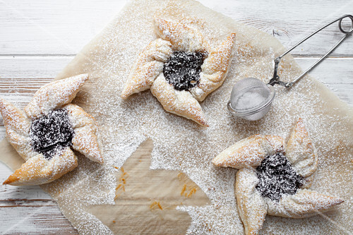 Traditional finnish Christmas stars, made from puff pastry and plum jam