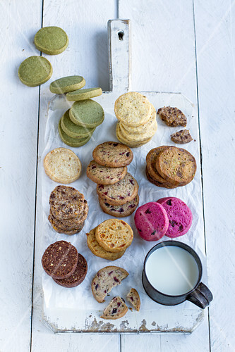 Various flavored cookies on a wooden board