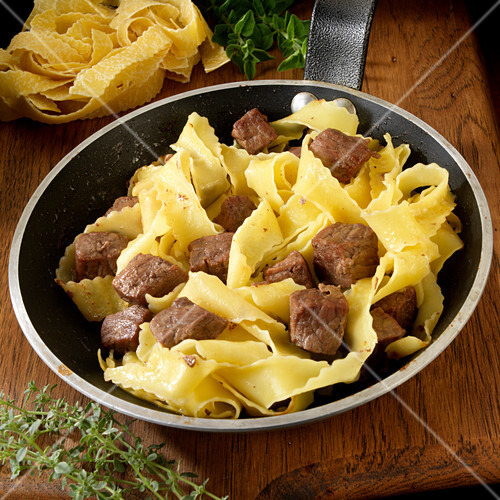 Beef and noodles in skillet