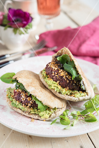 Beetroot falafel with avocado and chilli in pitta bread