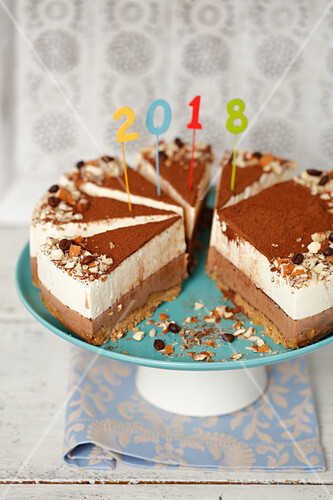Chocolate cream cheese cake decorated with a year