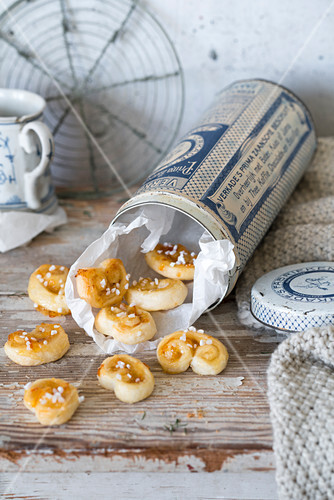 Orange and almond palmiers in a tin