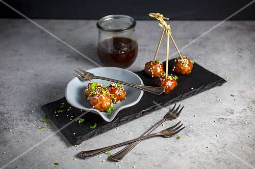 Meatballs with a Hoisin glaze and sesame seeds