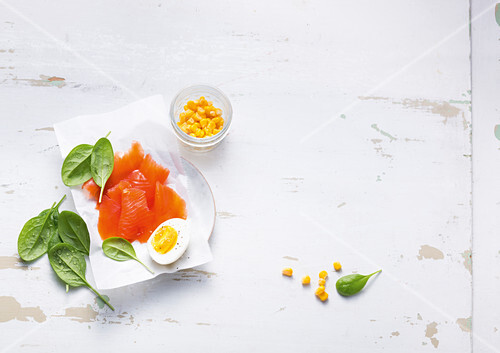 Smoked salmon, baby spinach, corn and a hard-boiled egg