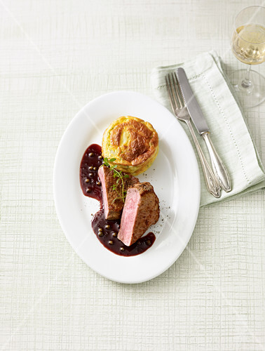 Veal steaks in red wine sauce with asparagus souffle