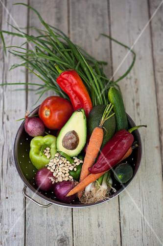 Fresh vegetables in a colander