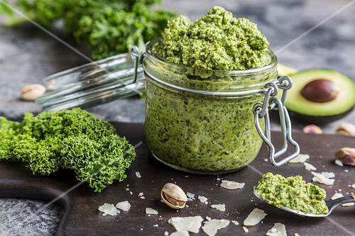 A jar of green kale pesto