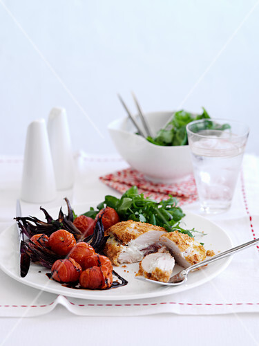 Chicken Cordon Bleu with roasted cherry tomatoes