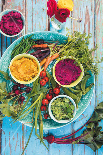 Carrot and ginger dip, beetroot and cauliflower dip, and pea and broccoli dip with mint