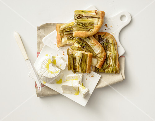 Focaccia with spring onions, served with ricotta
