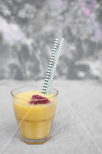 Smoothie made with pineapple, orange juice and banana