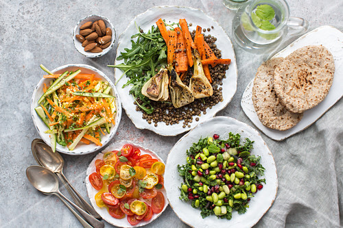 Various vegetable salads with pita bread