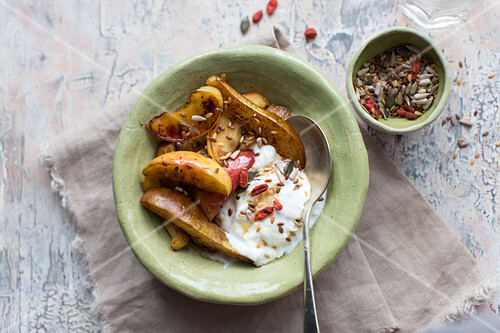 Baked apple and pear slices served with yoghurt, goji and seeds