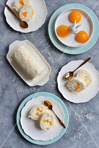 Meringue coconut roll with whipped cream and peaches