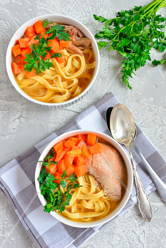 Broth with noodles and turkey