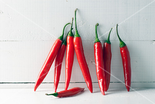 Fresh Red hot chili peppers on white background